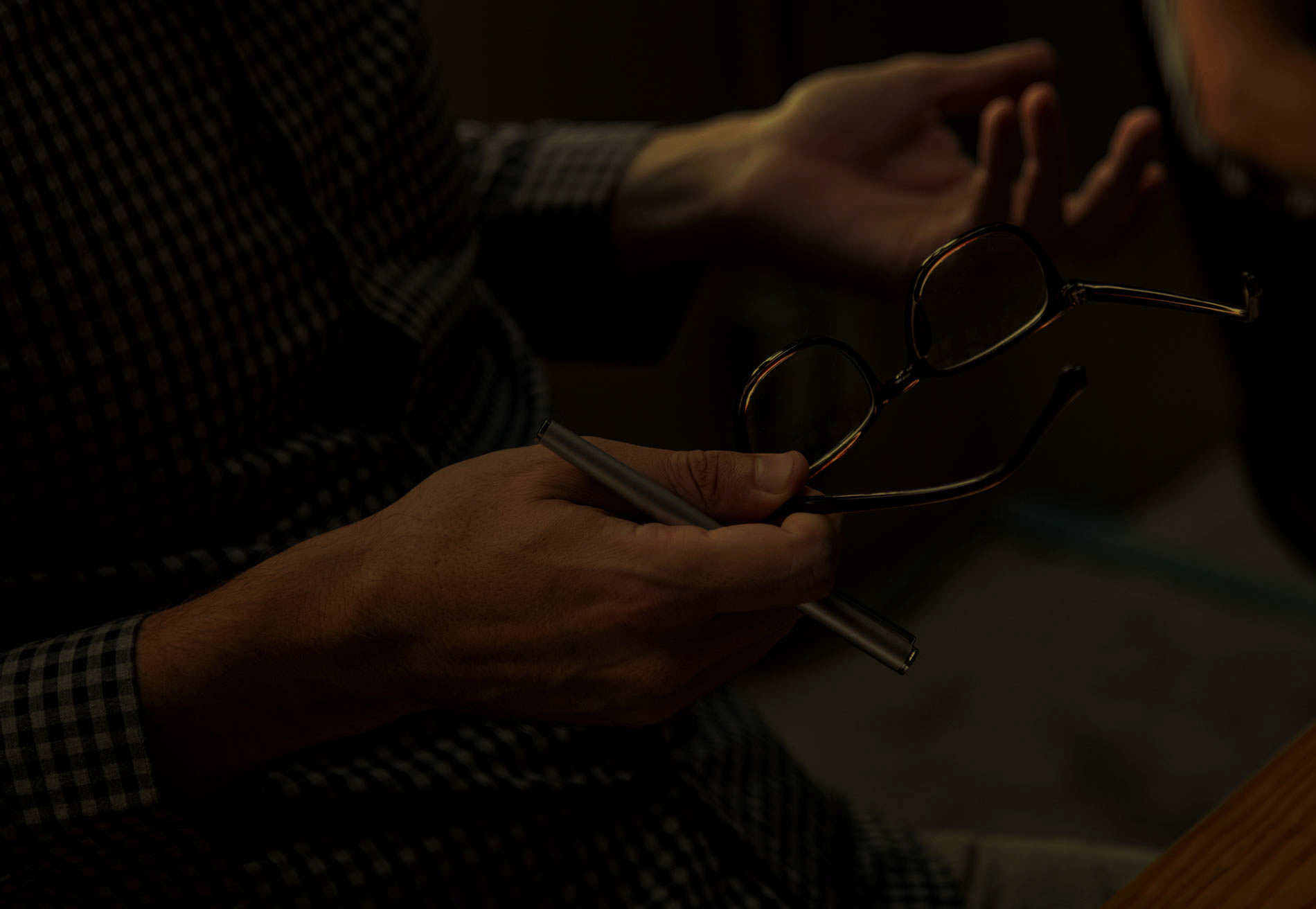 Man's hands with glasses